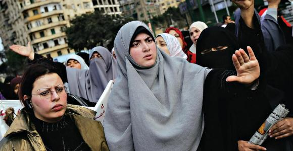 Women face a long struggle to attain equal rights in Egypt. Protesters in Cairo's Tahrir Square in February (CHRIS HONDROS/GETTY IMAGES) - Soure: New York Times